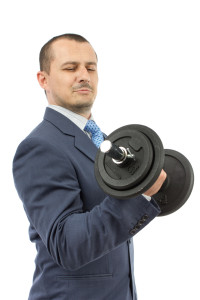 Businessman-lifts-weights