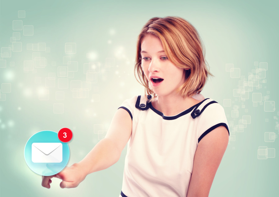 Young woman pointing at an email icon on light blue background