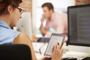 Businesswoman Using Digital Tablet In Creative Office